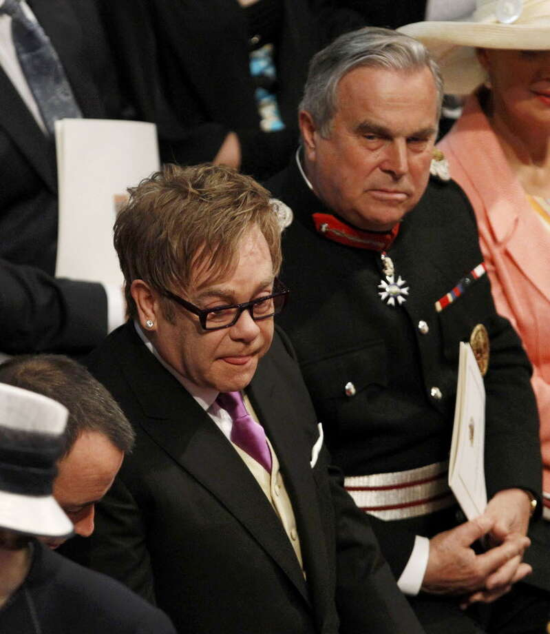 LONDON, ENGLAND - APRIL 29: Sir Elton John arrives at Westminster Abbey ahead of the Royal Wedding of Prince William to Catherine Middleton at Westminster Abbey on April 29, 2011 in London, England. The marriage of the second in line to the British throne is to be led by the Archbishop of Canterbury and will be attended by 1900 guests, including foreign Royal family members and heads of state. Thousands of well-wishers from around the world have also flocked to London to witness the spectacle and pageantry of the Royal Wedding. (Photo by Suzanne Plunkett - WPA Pool/Getty Images)