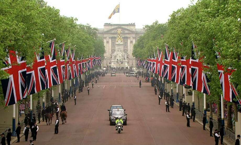 In this image taken from video, the car containing Britain's Prince William and Britain's Prince Harry drives down the Mall on it's way to Westminster Abbey for the Royal Wedding in London on Friday, April, 29, 2011.  EDITORIAL USE ONLY NO ARCHIVE PHOTO TO BE USED SOLELY TO ILLUSTRATE NEWS REPORTING OR COMMENTARY ON THE FACTS OR EVENTS DEPICTED IN THIS IMAGE Photo: APTN