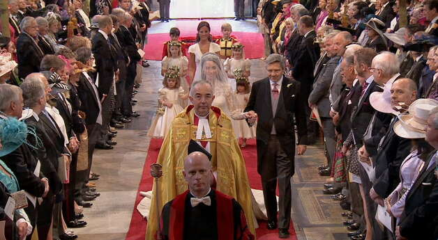 Kate Middleton walks down the aisle with her father, Michael Middleton, at Westminster Abbey for the Royal Wedding in London on Friday, April, 29, 2011. (AP Photo/APTN)