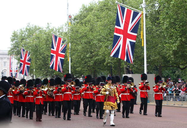 LONDON - APRIL 29: Ceremonial guards perform along the Mall ahead of the Royal Wedding of Prince William to Catherine Middleton at Westminster Abbey on April 29, 2011 in London, England. The marriage of the second in line to the British throne is to be led by the Archbishop of Canterbury and will be attended by 1900 guests, including foreign Royal family members and heads of state. Thousands of well-wishers from around the world have also flocked to London to witness the spectacle and pageantry of the Royal Wedding. (Photo by Julian Finney/Getty Images)