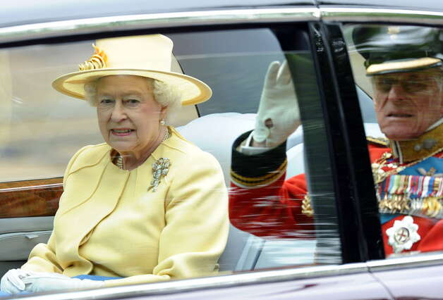 Britain's Queen Elizabeth II and the Duke of Edinburgh travel to Westminster Abbey in London, for the wedding of Britain?s Prince William and Kate Middleton in London on April 29, 2011. (PAUL ELLIS/AFP/Getty Images)