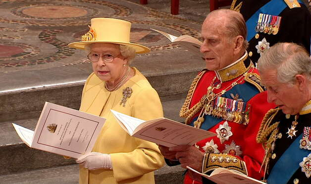 Queen Elizabeth II, Britain's Prince Philip, and Britain's Prince Charles sing during the ceremony at Westminster Abbey for the Royal Wedding in London on Friday, April, 29, 2011. (AP Photo/APTN)