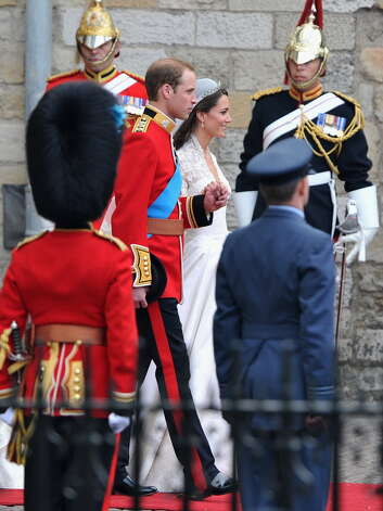 LONDON - APRIL 29: Their Royal Highnesses Prince William, Duke of Cambridge and Catherine, Duchess of Cambridge leave the Abbey before making the journey by carriage procession to Buckingham Palace following their marriage at Westminster Abbey on April 29, 2011 in London, England. The marriage of the second in line to the British throne was led by the Archbishop of Canterbury and was attended by 1900 guests, including foreign Royal family members and heads of state. Thousands of well-wishers from around the world have also flocked to London to witness the spectacle and pageantry of the Royal Wedding. (Photo by Dan Kitwood/Getty Images)