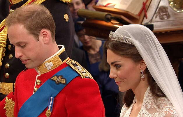 Britain's Prince William, left, stands at the altar with his wife, Kate, the Dutchess of Cambridge, at Westminster Abbey for the Royal Wedding in London on Friday, April, 29, 2011. (AP Photo/APTN)
