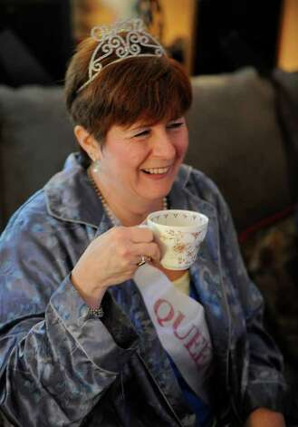 Suzanne Baker takes a sip of coffee as she hosts at royal wedding slumber party at her Averill Park home to watch Prince William and Princess Kate's wedding on April 29, 2011.   (Skip Dickstein/ Times Union) Photo: Skip Dickstein