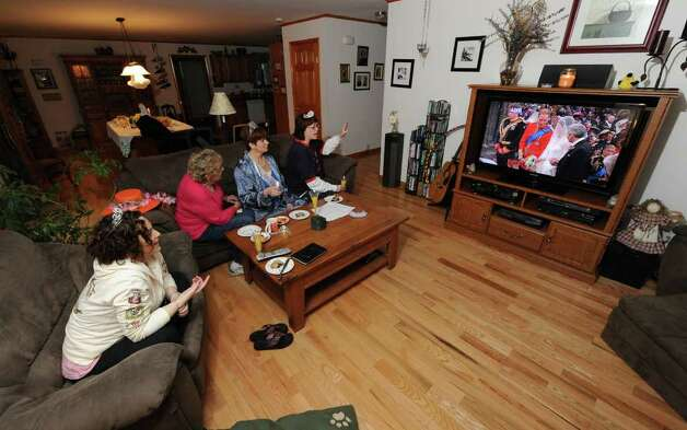 Suzanne Baker, center, on couch hosts a royal wedding slumber party to watch Prince William and Princess Kate's wedding on Friday, April 29, 2011. Joining her are Sara LeCain, left, Jan Hoffman, second from left, party host Suzanne Baker, second from right, and Elaine Bedell, right.(Skip Dickstein/ Times Union) Photo: Skip Dickstein