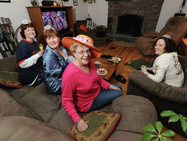 Suzanne Baker, center on couch  hosts a Royal Wedding Slumber Party to watch William and Kate's wedding at her home in Averill Park, N.Y. April 29, 2011.   Joining her are Sara LeCain, right; Jan Hoffman, second from right,  Party Host Suzanne Baker, second from right and Elaine Bedell, left.(Skip Dickstein/ Times Union) Photo: Skip Dickstein