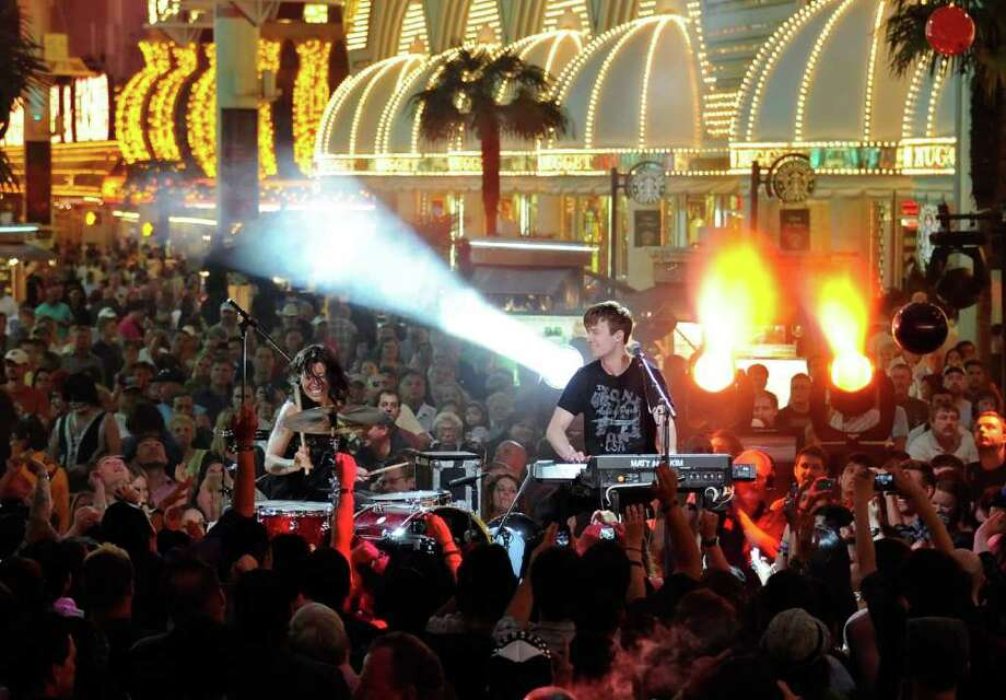"LAS VEGAS, NV - APRIL 28:  Recording artists Kim Schifino (L) and Matt Johnson of the band Matt & Kim perform during MTV's inaugural ""O Music Awards"" at the Fremont Street Experience April 28, 2011 in Las Vegas, Nevada.  (Photo by Ethan Miller/Getty Images) *** Local Caption *** Kim Schifino;Matt Johnson; Photo: Getty Images"