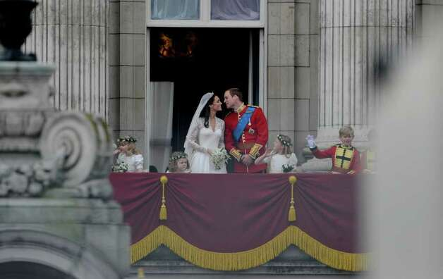 Britain's Prince William leans to kiss his wife Kate, Duchess of Cambridge, on the balcony of Buckingham Palace in London, after their wedding ceremony, on April 29, 2011.  AFP PHOTO / LEON NEAL (Photo credit should read PIERRE-PHILIPPE MARCOU/AFP/Getty Images) Photo: PIERRE-PHILIPPE MARCOU / AFP