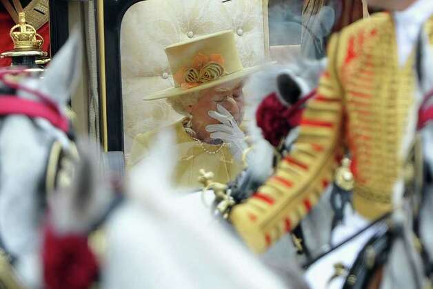 LONDON, ENGLAND - APRIL 29:  Queen Elizabeth II makes the journey by carriage procession to Buckingham Palace after the Royal Wedding of Prince William, Duke of Cambridge and Catherine, Duchess of Cambridge at Westminster Abbey on April 29, 2011 in London, England. The marriage of the second in line to the British throne was led by the Archbishop of Canterbury and was attended by 1900 guests, including foreign Royal family members and heads of state. Thousands of well-wishers from around the world have also flocked to London to witness the spectacle and pageantry of the Royal Wedding.  (Photo by Pascal Le Segretain/Getty Images) Photo: Pascal Le Segretain / 2011 Getty Images