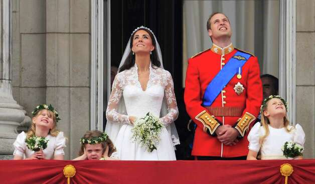 Britain's Prince William and his wife Kate, Duchess of Cambridge watch a fly past of military planes from the balcony of Buckingham Palace after the Royal Wedding in London Friday, April, 29, 2011. (AP Photo/Matt Dunham) Photo: Matt Dunham / AP