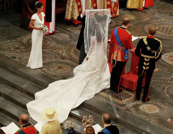 Michael Middleton, second left, Kate Middleton's father, lifts her veil as she and Britain's Prince William, 2nd right, are flanked by best man Prince Harry, right, and maid of honour Pippa Middleton, left, during the wedding service at Westminster Abbey at the Royal Wedding in London Friday, April, 29, 2011. (AP Photo/Kirsty Wigglesworth, pool) Photo: Kirsty Wigglesworth / POOL AP