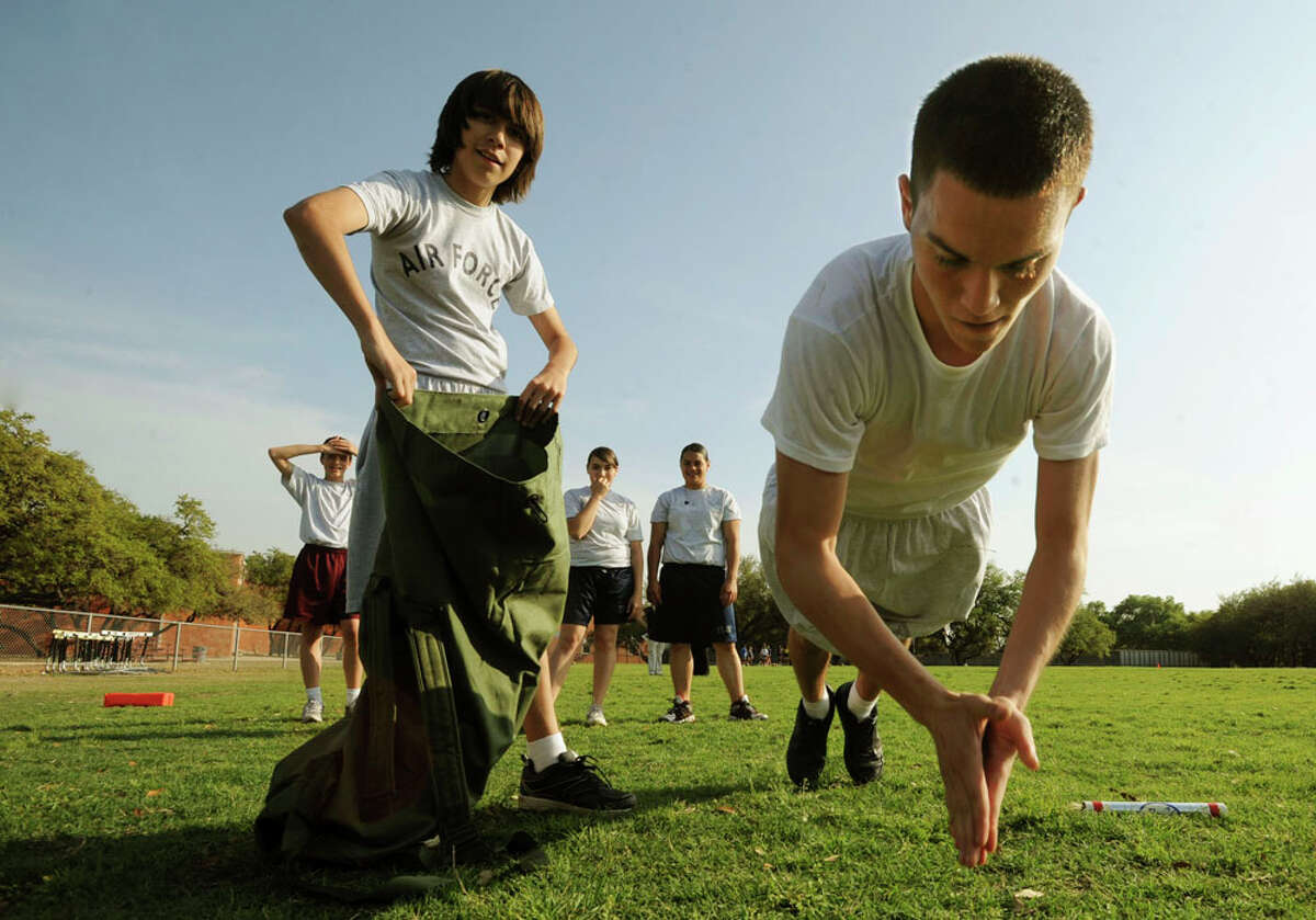 Isaiah Salinas, 14, who attends Stevenson Middle School, executes handclap pushups during an outing with members of the Taft High School Air Force JROTC. BILLY CALZADA / EXPRESS-NEWS