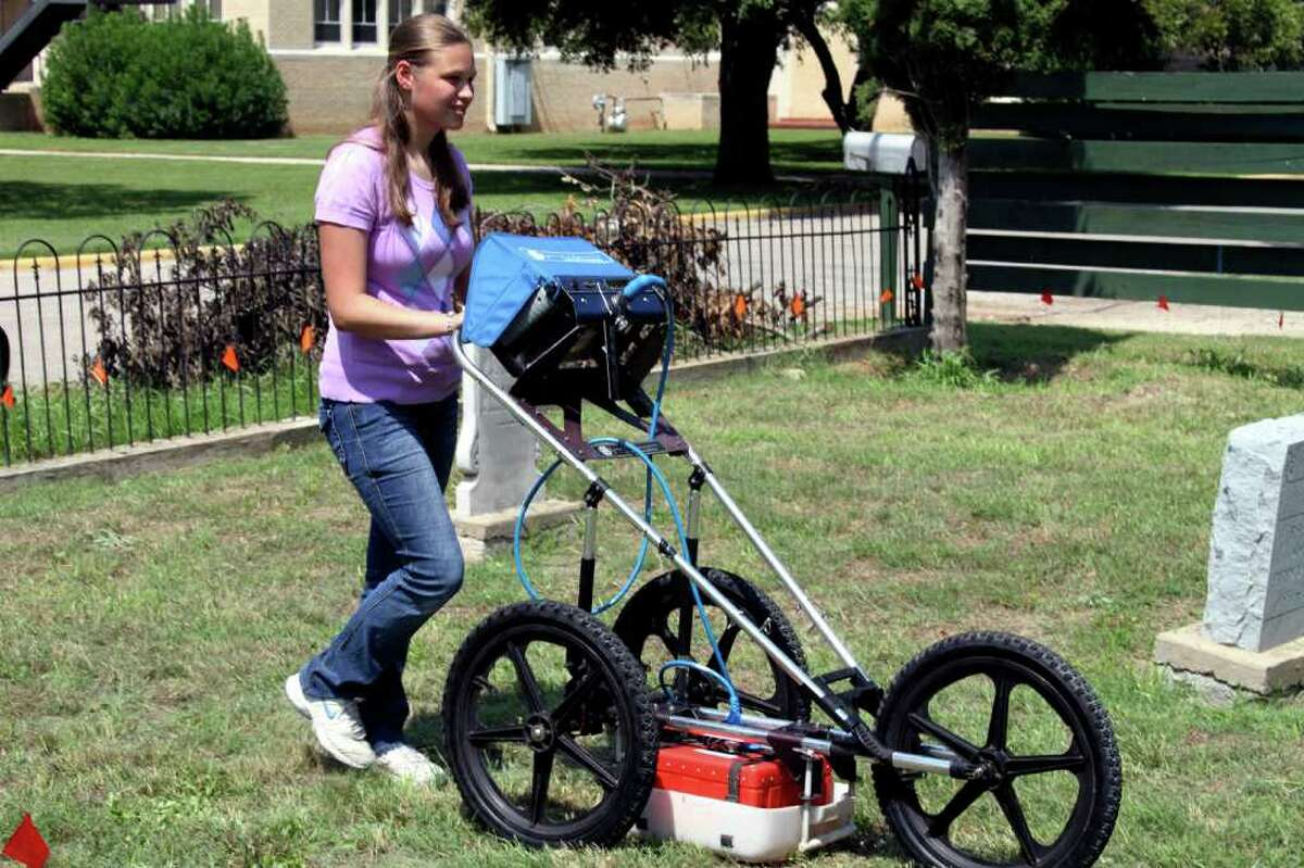Lauren Mandaville used ground penetrating radar to find unmarked nineteenth century graves at Seguin's Vaughn cemetery. Photograph by Forrest M. Mims III.