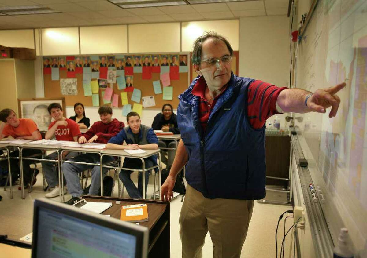 John Dasher leads his AP US History class in a discussion of the political climate in the 1960's at Fairfield Warde High School on Tuesday, March 29, 2011.