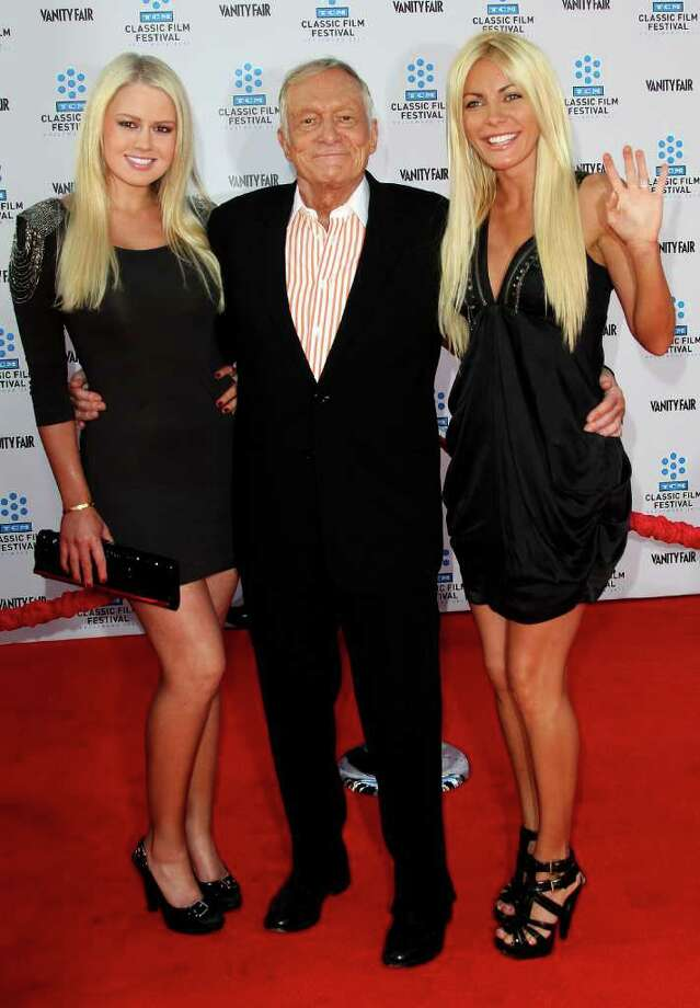 "(L-R) Guest, Playboy founder Hugh Hefner and his fiancee Crystal Harris attend the TCM Classic Film Festival Opening Night Gala and World Premiere of the film ""An American In Paris"" at Grauman's Chinese Theatre in Hollywood, California.  Photo: Getty Images"