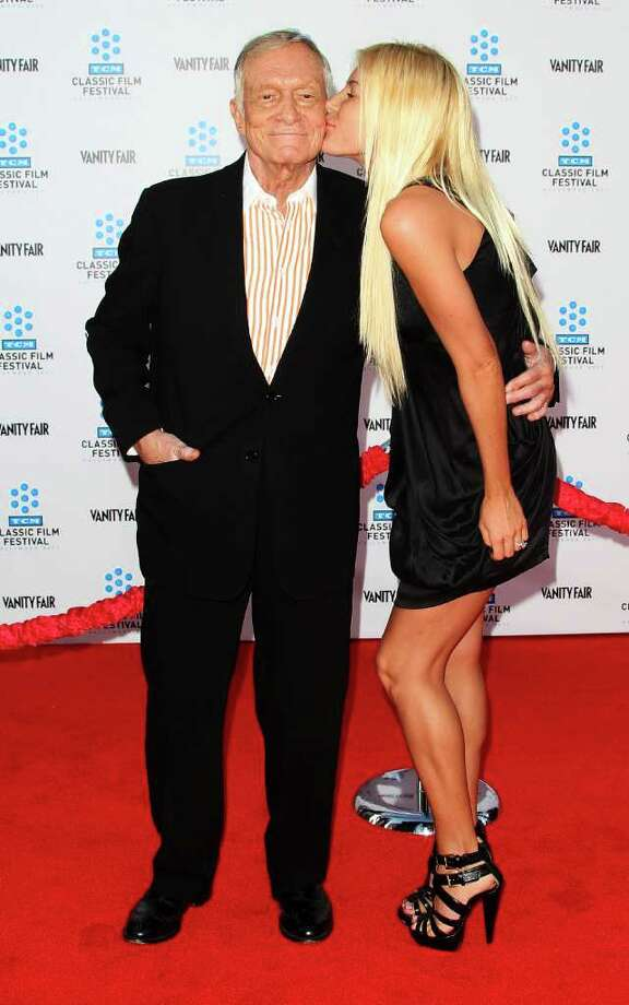 """Playboy founder Hugh Hefner (L) and his fiancee Crystal Harris attend the TCM Classic Film Festival Opening Night Gala and World Premiere of the film """"An American In Paris"""" at Grauman's Chinese Theatre in Hollywood, California.  Photo: Getty Images"""