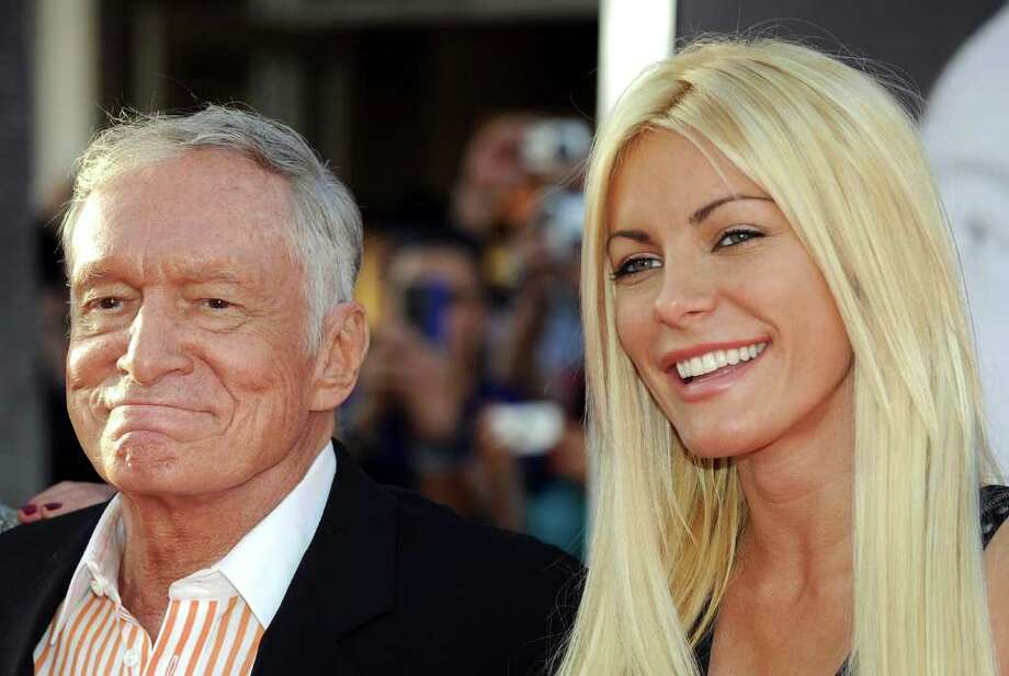 "Playboy magazine founder Hugh Hefner arrives with his fiancee Crystal Harris at the TCM Classic film Festival opening night and World premiere of the newly restored ""An american in Paris"" in Hollywood, California. Photo: AFP/Getty Images"