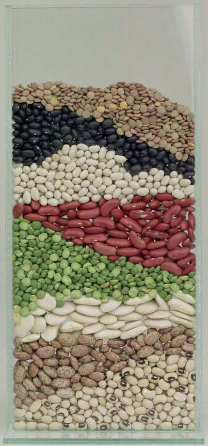 CONTACT FILED:  BEANS 09/14/99 (E. Joe Deering) Studio shot of a flat vase filled with layers of beans for food cover. Top to Bottom:  Lentils, Black beans, Navy beans, Red Kidney beans, Green Split Peas, Large Lima beans, Pinto beans and Black-eyed peas. SKYBOX HOUCHRON CAPTION (09/22/1999):  Colorful beans are soaking up cultures all over the globe.  HOUCHRON CAPTION (09/22/1999):  Beans serve as a blank - albeit colorful - canvas for culinary creativity, as they easily absorb flavors. Photo: E. Joseph Deering, Staff / Houston Chronicle