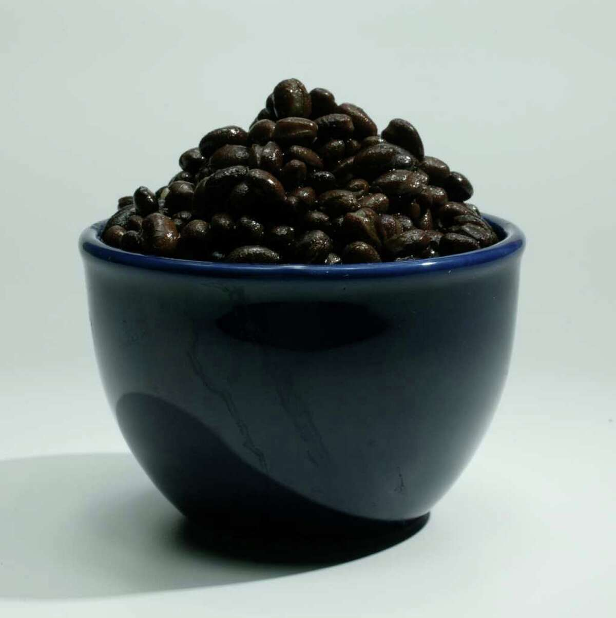 A bowl of black beans was shot in studio, 6/23/04, for a Food Cover. (Buster Dean / Chronicle). HOUCHRON CAPTION (07/07/2004): Satisfy the vegetarian in your life. Add cooked rice and canned corn to mashed or pureed beans for a meat-and fish-free option.