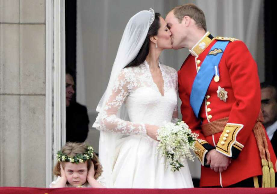 Britain's Prince William kisses his wife Kate, Duchess of Cambridge, on the balcony of Buckhingham Palace, after their wedding service, on April 29, 2011, in London. AFP PHOTO / LEON NEAL (Photo credit should read LEON NEAL/AFP/Getty Images) Photo: LEON NEAL, Staff / AFP