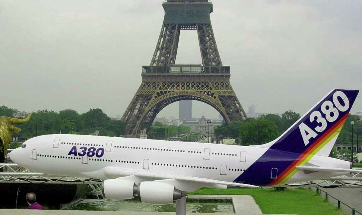 A model of French aircraft maker Airbus' latest commercial airliner, the Airbus A380, is exhibited on the Trocadero esplanade in front of the Eiffel Tower, Friday June 8, 2001, in Paris, ahead of the 44th Paris Air Show due to start Saturday June 16, at Le Bourget airport, north of Paris.