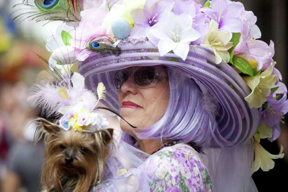 An Easter parade participant and her dog take part in the 2011 Easter Parade and Easter Bonnet Festival on April 24, 2011 in New York City. The parade is a New York tradition that started back approximately in the mid-1800s when the social elite would demonstrate their fashionable clothes while walking down Fifth Avenue after attending Easter services and celebrations in one of the Fifth Avenue churches. Photo: Getty Images