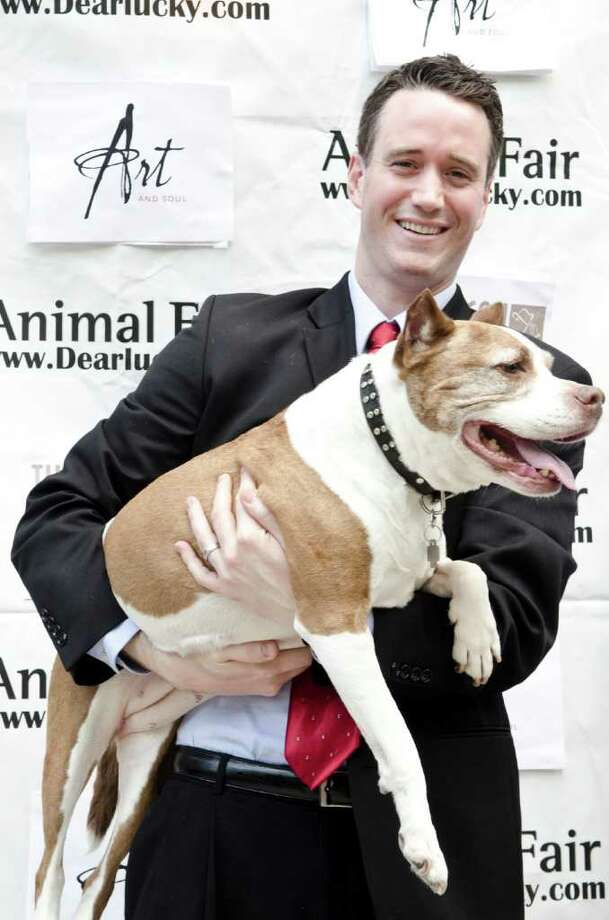 Dave Sharpe with his dog Cheyenne pose for a photo during the 2nd Annual White House Pet Correspondents benefit at Art and Soul's Pooch Patio on April 28, 2011 in Washington, D.C. Photo: Getty Images