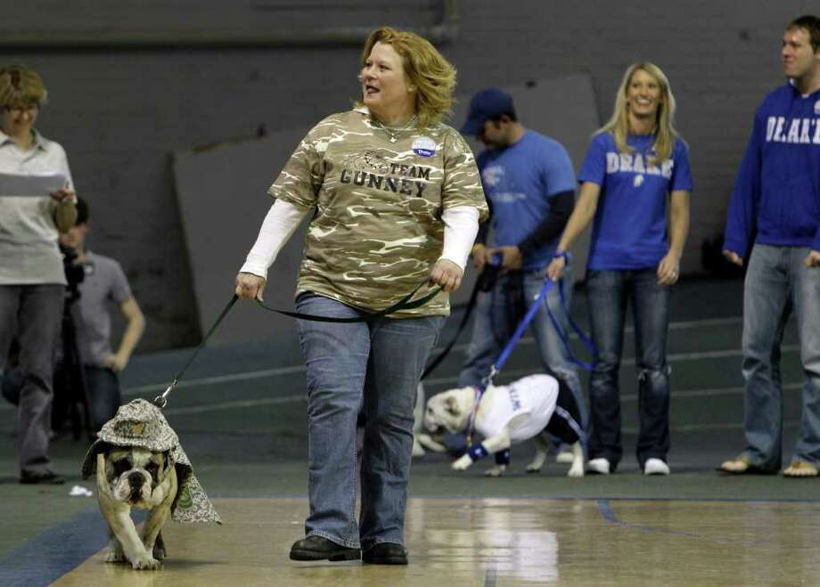 Deb Musselman, of Carlisle, Iowa, shows her dog Gunney during the 32nd annual Drake Relays Beautiful Bulldog Contest Monday, April 25, 2011, in Des Moines, Iowa. The pageant kicks off the Drake Relays festivities at Drake University where a bulldog is the mascot. Photo: AP