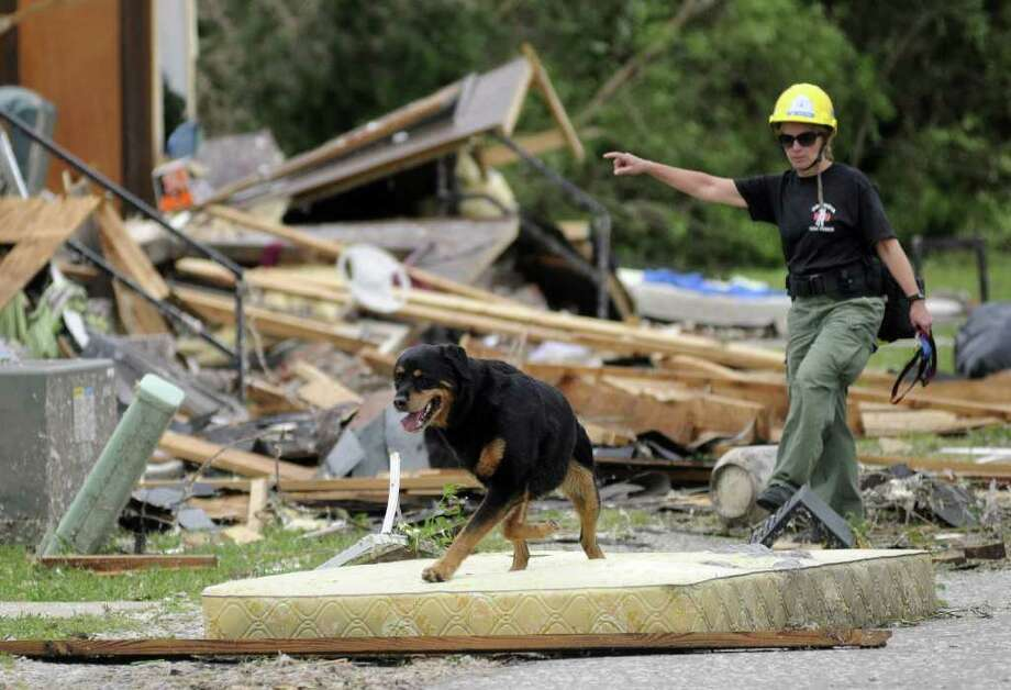 Teresa Christian and her search dog, Jake, work through an apartment complex in Trenton, Ga. on Thursday, April 28, 2011, after overnight storms hit the North Georgia and Chattanooga, Tenn. area. Photo: AP