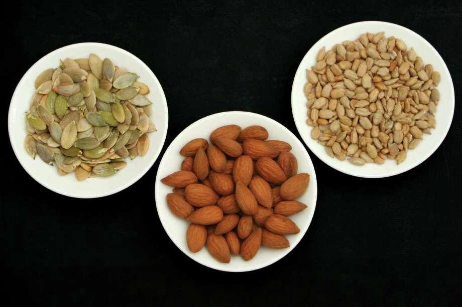 Top view of various seeds: L-R pumpkin seeds, almond and sunflower seeds.  nuts Photo: Szasz-Fabian Jozsef / handout / stock agency