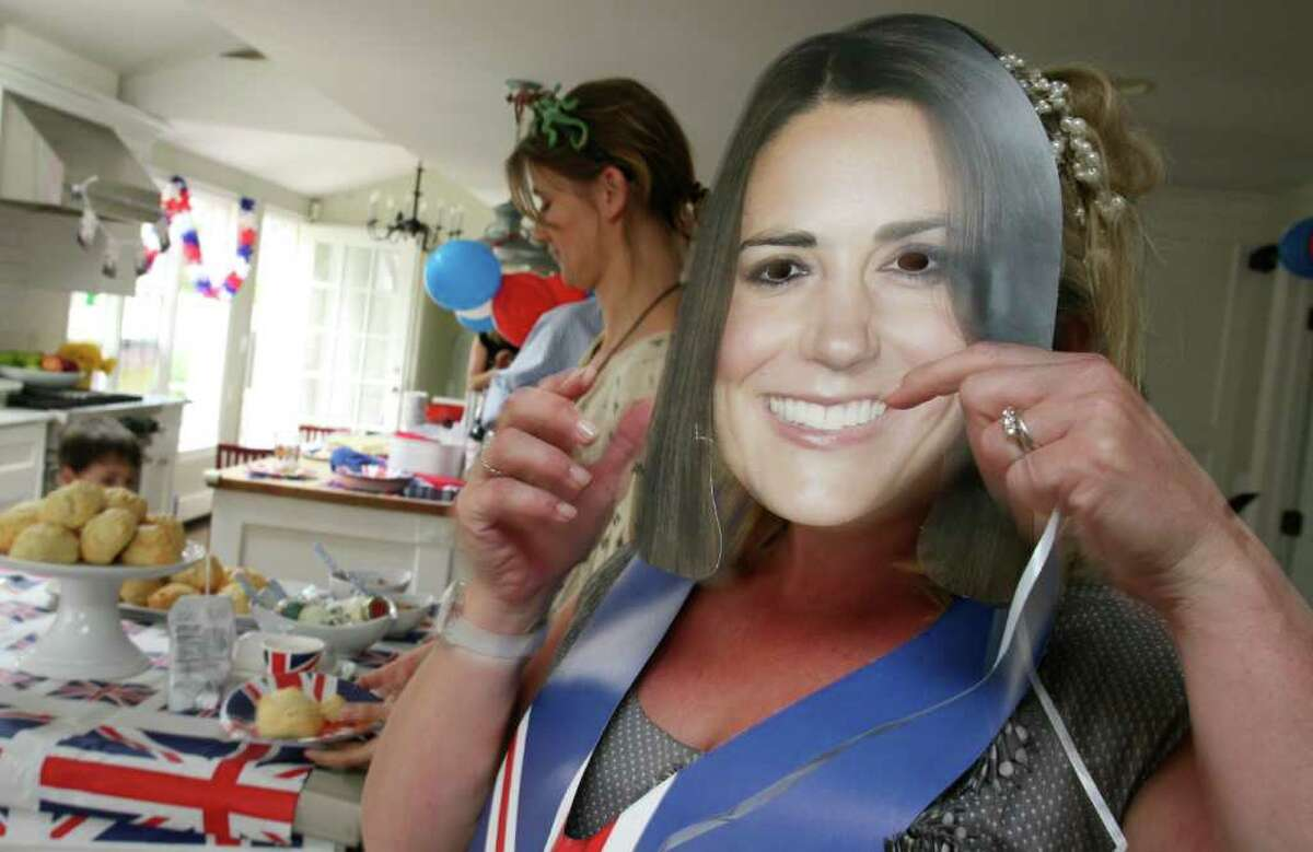 British expat Louise Underwood dons a Kate Middleton mask Friday afternoon, April 29, 2011, Underwood hosted a royal wedding party at her home in Old Greenwich to celebrate Prince William and Kate Middleton's marriage Friday.