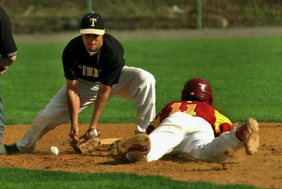 Trumbull's #4 Anthony Matera can't get the tag out on St. Joseph's #11 Jerry Kramer in a stolen base play, during boys baseball action in Trumbull, Conn. on Friday April 29, 2011. Photo: Christian Abraham / Connecticut Post