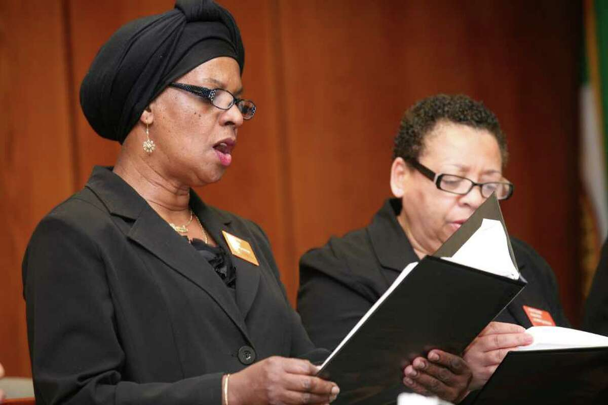 Choir of First Baptist Church members Carol Mitchell, left, and Patricia Laird performed during Friday morning's Stand Against Racism Day event, which was sponsored by the YWCA Greenwich and held at Town Hall.