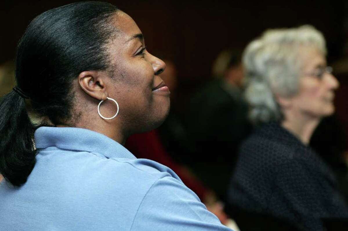 Silvia Griffin listens to the First Baptist Church choir during Friday morning's second annual YWCA Greenwich Stand Against Racism Day event held at Town Hall.