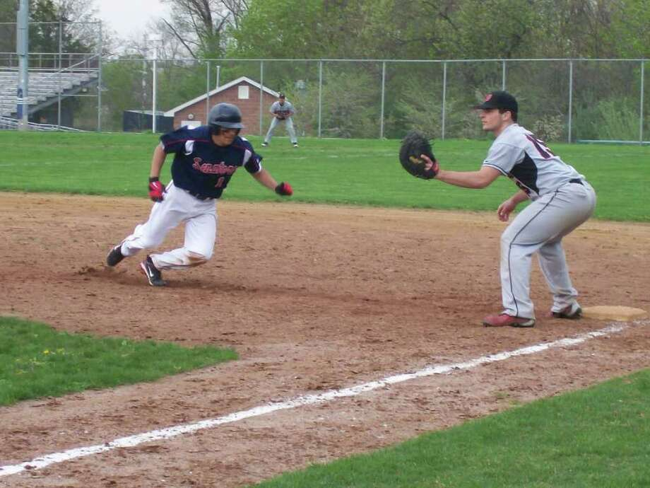 Brien McMahon second baseman Jamie Restivo prepares to slide in safely back to first as a pickoff throw is sent his way in the Senators' 6-5 win over Fairfield Warde Friday. Photo: Doug Bonjour / Norwalk Citizen