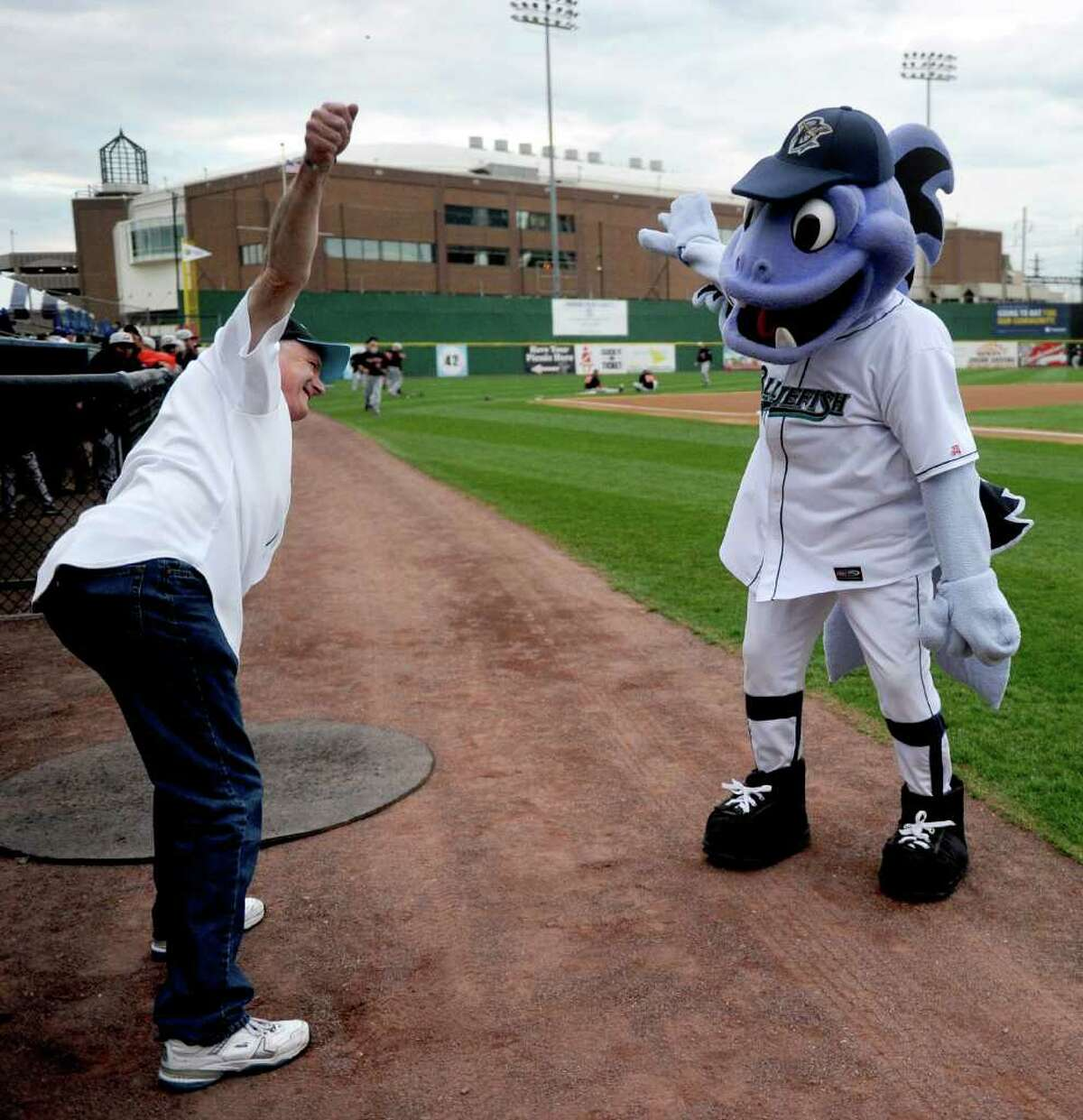 Bridgeport Mayor Bill Finch gets some warm-up advice from Bluefish mascot B.B before throwing out the first pitch during Friday's Bluefish game at the Ballpark at Harbor Yard in Bridgeport on April 29, 2011.