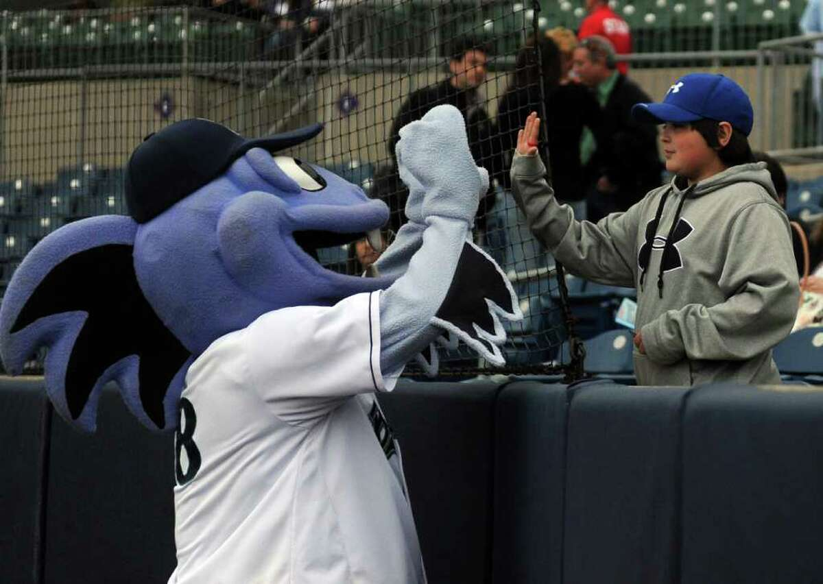 B.B. the Bluefish gives Jake Comeau, 13, a high-five before Friday's Bluefish game at the Ballpark at Harbor Yard in Bridgeport on April 29, 2011.