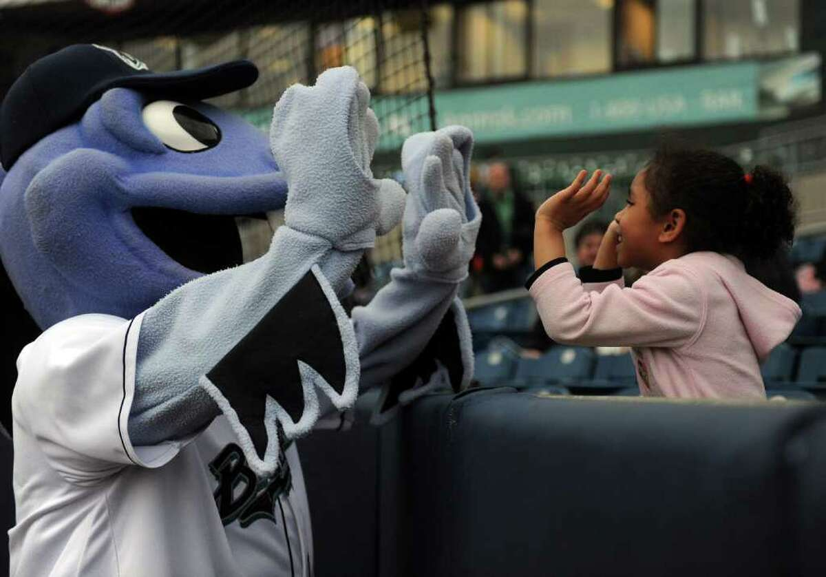 B.B. the Bluefish gives Nialana Pope, 5, a double-high-five before Friday's Bluefish game at the Ballpark at Harbor Yard in Bridgeport on April 29, 2011.