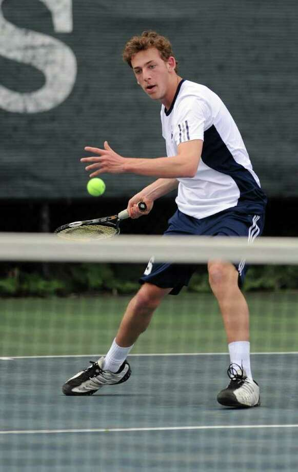 Jesse Heussner plays tennis during Friday's game against Greenwich in Westport on April 29, 2011. Photo: Lindsay Niegelberg / Connecticut Post