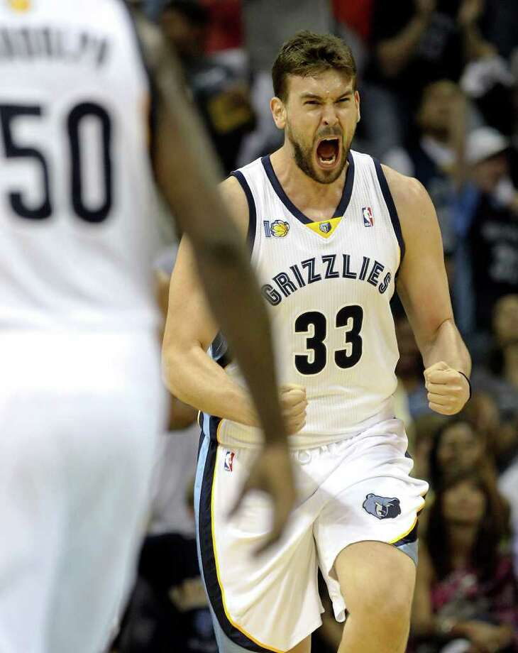 Memphis Grizzlies' Marc Gasol reacts after a score against the Spurs in the first half in Game 6 of the first round of the Western Conference playoff at the FedEx Forum in Memphis on Friday, April 29, 2011. Kin Man Hui/kmhui@express-news.net Photo: KIN MAN HUI, Kin Man Hui/kmhui@express-news.net / San Antonio Express-News NFS