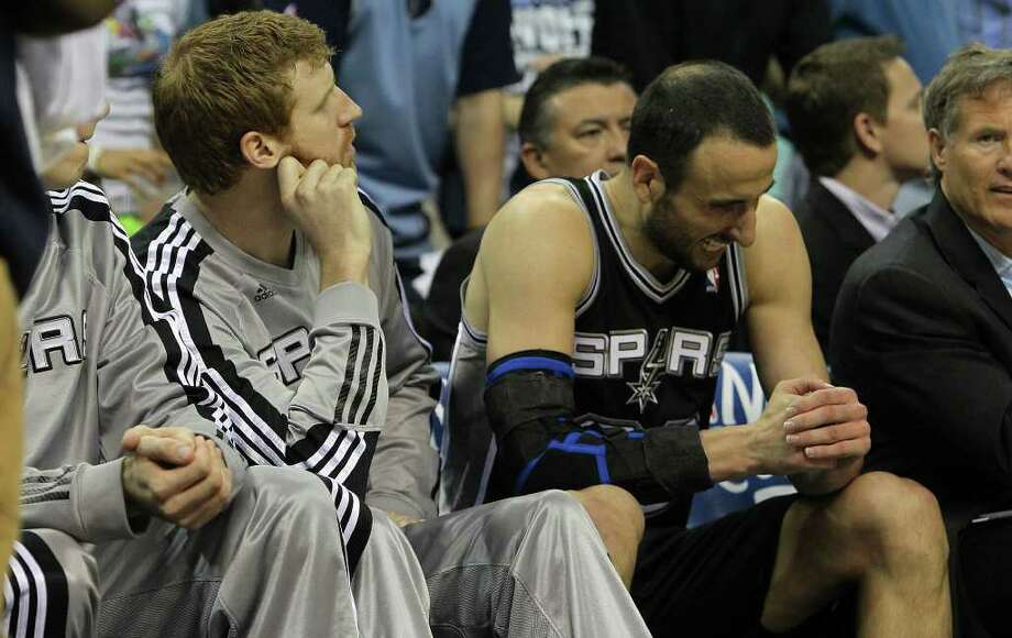 Spurs' Manu Ginobili (right) grimaces after returning to the bench in the first quarter against the Memphis Grizzlies in Game 6 of the first round of the Western Conference playoff at the FedEx Forum in Memphis on Friday, April 29, 2011. Kin Man Hui/kmhui@express-news.net Photo: KIN MAN HUI, Kin Man Hui/kmhui@express-news.net / San Antonio Express-News NFS