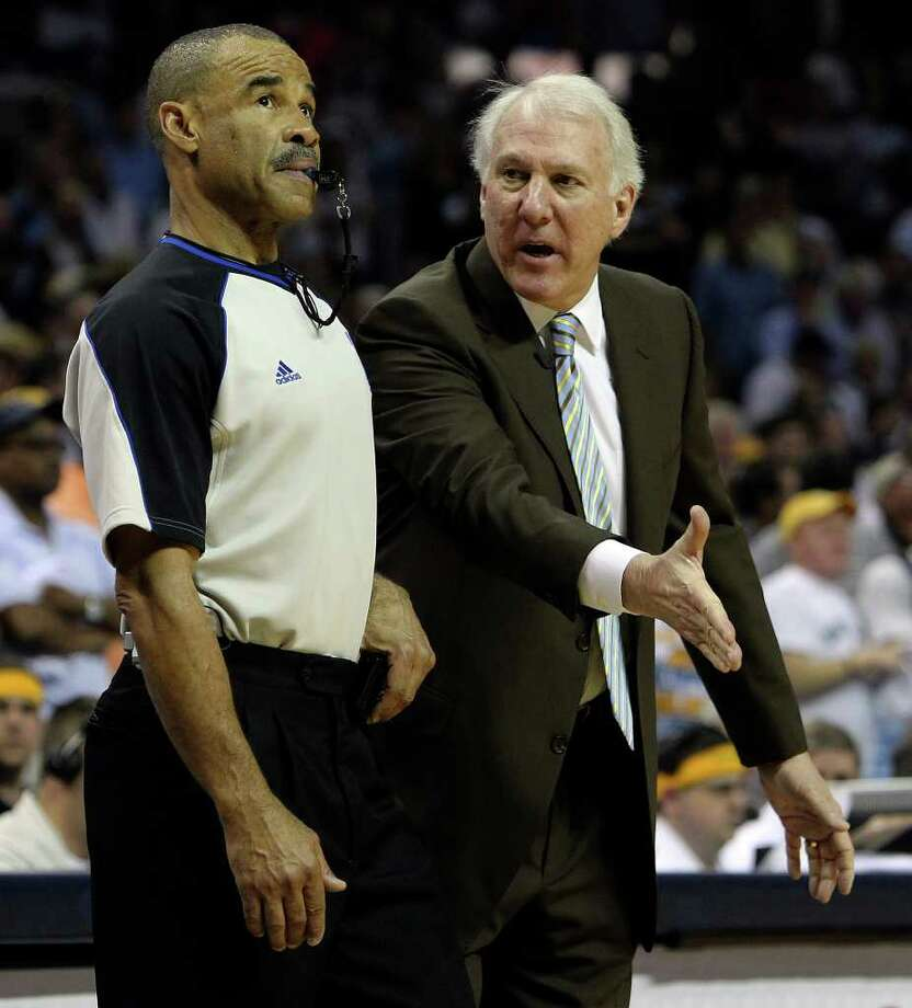 Spurs coach Gregg Popovich pleads his case to a game official in the second half in Game 6 against the Memphis Grizzlies of the first round of the Western Conference playoff at the FedEx Forum in Memphis on Friday, April 29, 2011. Spurs lose 91-99. Kin Man Hui/kmhui@express-news.net Photo: KIN MAN HUI, Kin Man Hui/kmhui@express-news.net / San Antonio Express-News NFS