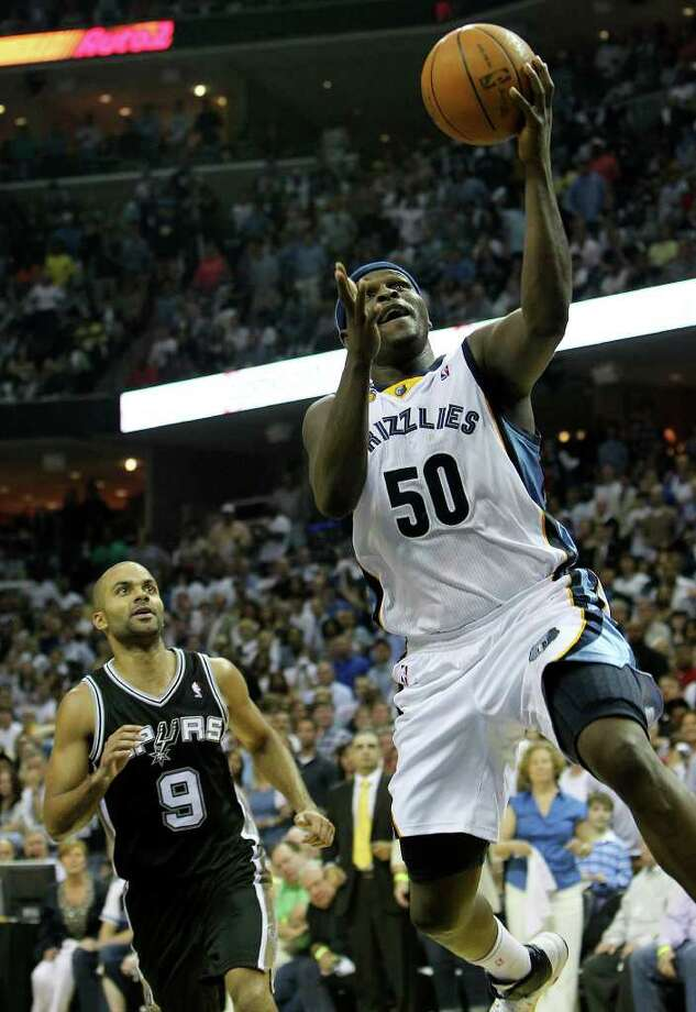 Memphis Grizzlies' Zach Randolph (50) goes in for a score past Spurs' Tony Parker in the second half in Game 6 of the first round of the Western Conference playoff at the FedEx Forum in Memphis on Friday, April 29, 2011. Spurs lose 91-99. Kin Man Hui/kmhui@express-news.net Photo: KIN MAN HUI, Kin Man Hui/kmhui@express-news.net / San Antonio Express-News NFS
