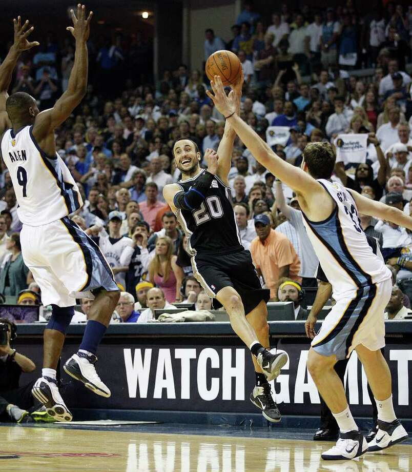 SPURS -- San Antonio Spurs Manu Ginobili passes through Memphis Grizzlies Tony Allen and Marc Gasol during second half of game six of the Western Conference First Round at FedExForum, Friday, April 29, 2011. The lost 99-91 and the series 4-2. JERRY LARA/glara@express-news.net Photo: JERRY LARA, JERRY LARA/glara@express-news.net / SAN ANTONIO EXPRESS-NEWS (NFS)