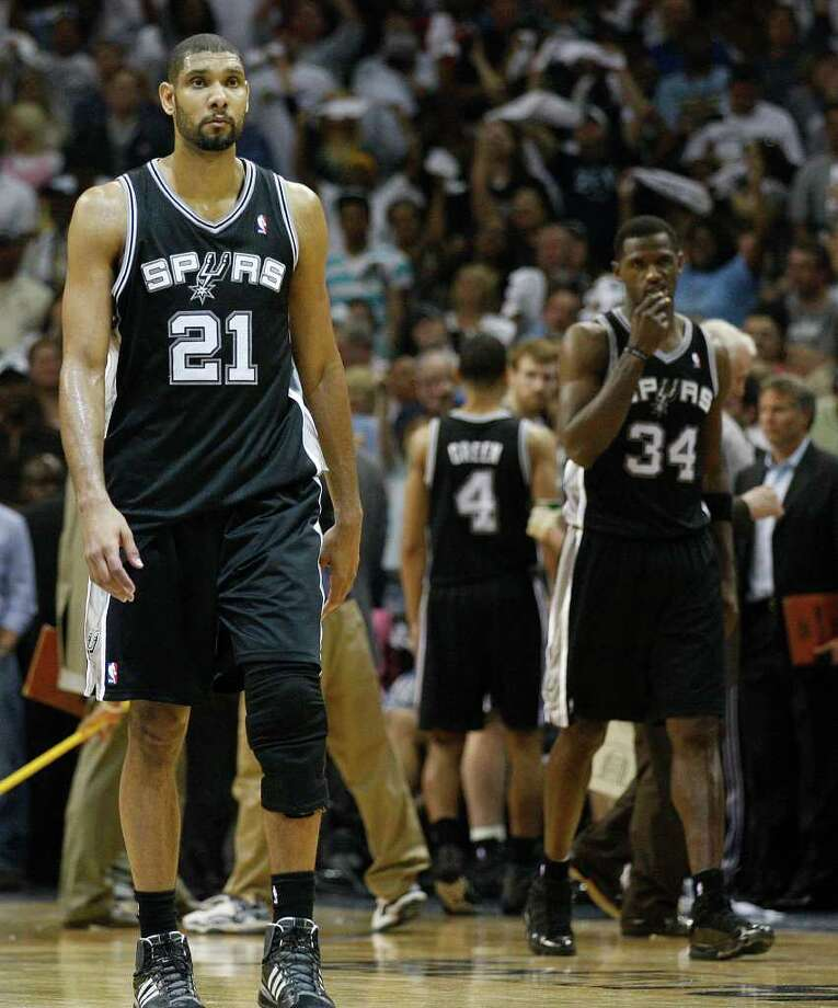 SPURS -- San Antonio Spurs Tim Duncan and Antonio McDyess watch as they lose to the Memphis Grizzlies 99-91 ib game six of the Western Conference First Round at FedExForum, Friday, April 29, 2011. JERRY LARA/glara@express-news.net Photo: JERRY LARA, JERRY LARA/glara@express-news.net / SAN ANTONIO EXPRESS-NEWS (NFS)