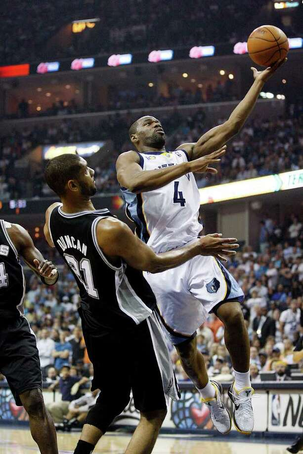 SPURS -- Memphis Grizzlies Sam Young drives through San Antonio Spurs Tim Duncan during first half of game six of the Western Conference First Round at FedExForum, Friday, April 29, 2011. JERRY LARA/glara@express-news.net Photo: JERRY LARA, JERRY LARA/glara@express-news.net / SAN ANTONIO EXPRESS-NEWS (NFS)