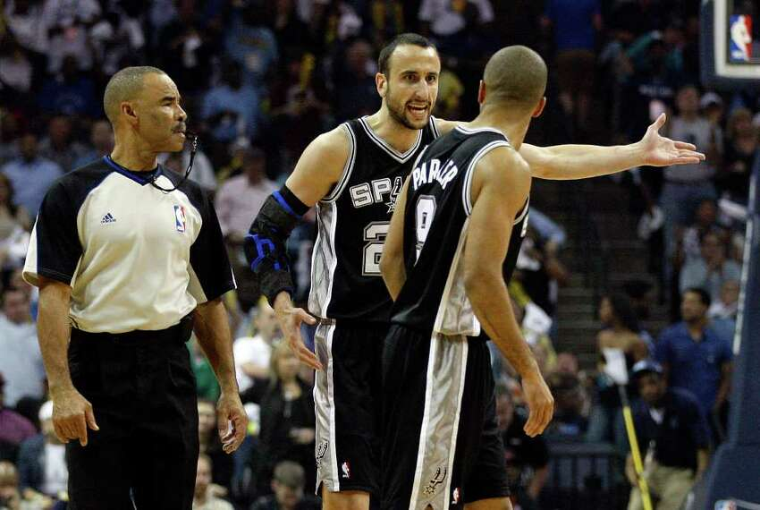 SPURS -- San Antonio Spurs Manu Ginobili talks about a play with Tony Parker and official Dan Crawford during first half of game six of the Western Conference First Round at FedExForum, Friday, April 29, 2011. JERRY LARA/glara@express-news.net