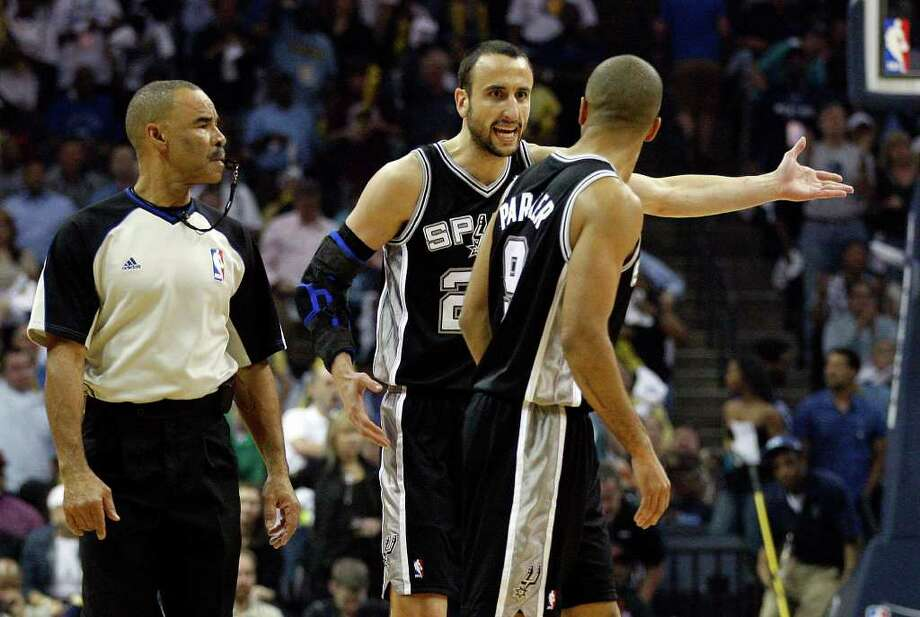 SPURS -- San Antonio Spurs Manu Ginobili talks about a play with Tony Parker and official Dan Crawford during first half of game six of the Western Conference First Round at FedExForum, Friday, April 29, 2011. JERRY LARA/glara@express-news.net Photo: JERRY LARA, JERRY LARA/glara@express-news.net / SAN ANTONIO EXPRESS-NEWS (NFS)