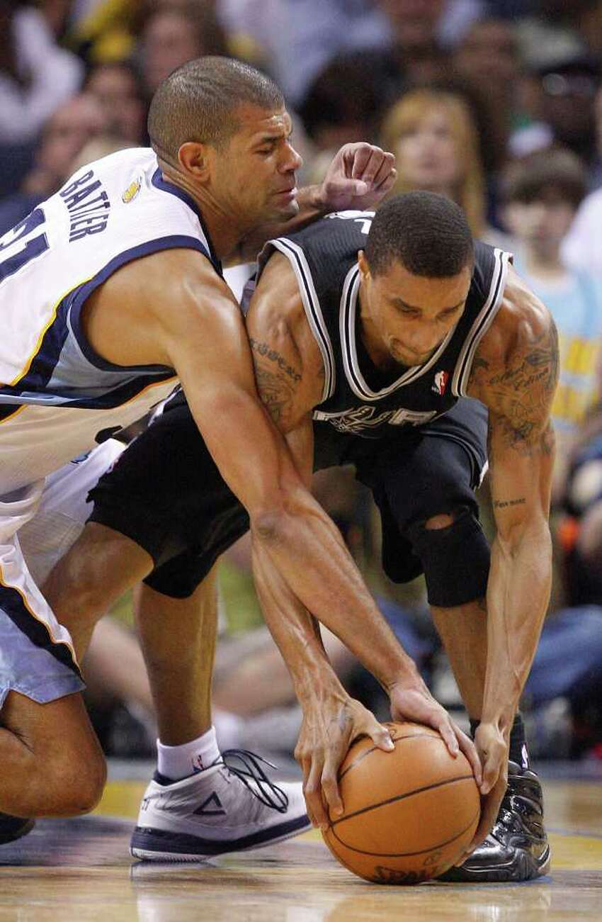 SPURS -- San Antonio Spurs George Hill scrambles for the ball agaisnt Memphis Grizzlies Shane Battier during first half of game six of the Western Conference First Round at FedExForum, Friday, April 29, 2011. JERRY LARA/glara@express-news.net